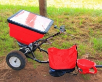 A ground-drive broadcast spreader/seeder used for planting cover crops.