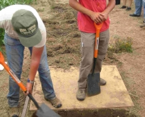 Katie and Jacob demonstrate the biointensive double-digging technique. The board that they stand on distributes their weight, lessening soil compaction.