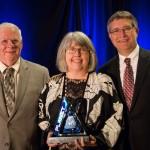 L-r: Jim Horne, Maura McDermott and David Redhage with the Bellmon Award for Environmental Stewardship.