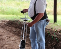 George Kuepper demonstrates the Earthway seeder.