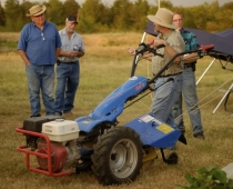 George Kuepper discusses the BCS 853 walk-behind tractor at a field day.